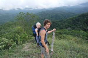 Father hiking with young son