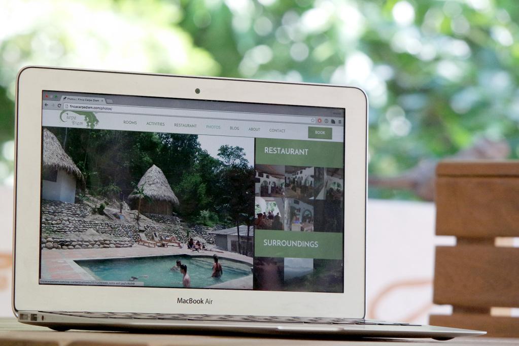 Finca Carpe Diem website on laptop