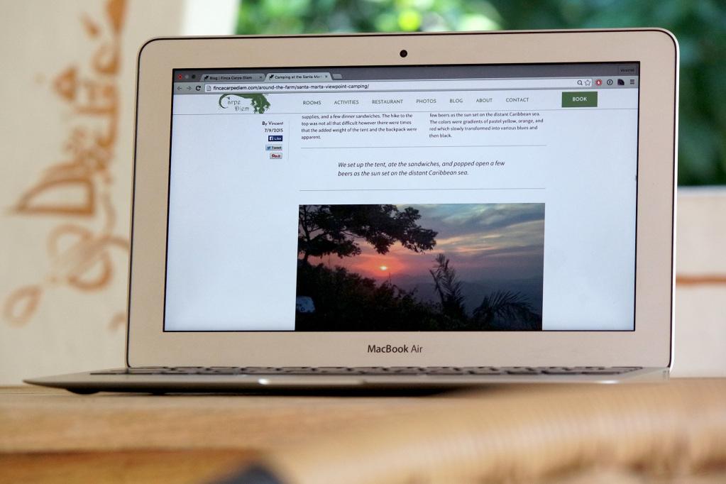Finca Carpe Diem's website on a laptop screen