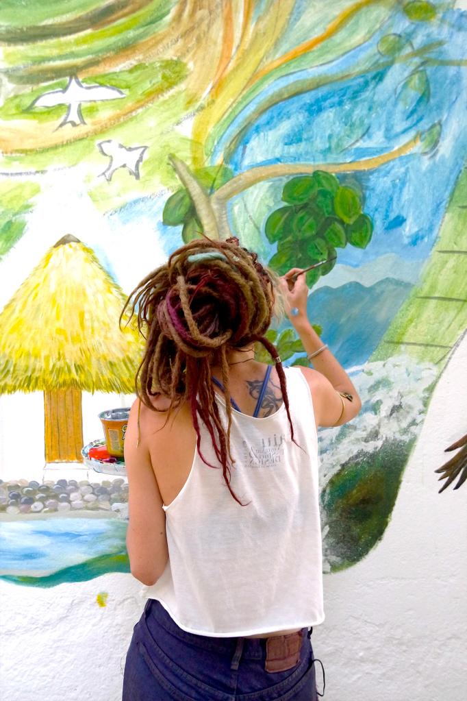 Painting a mural at Finca Carpe Diem